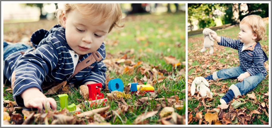 A two year old boy playing with his toys on the grass at by the river at Canbury Gardens in Kingston upon thames