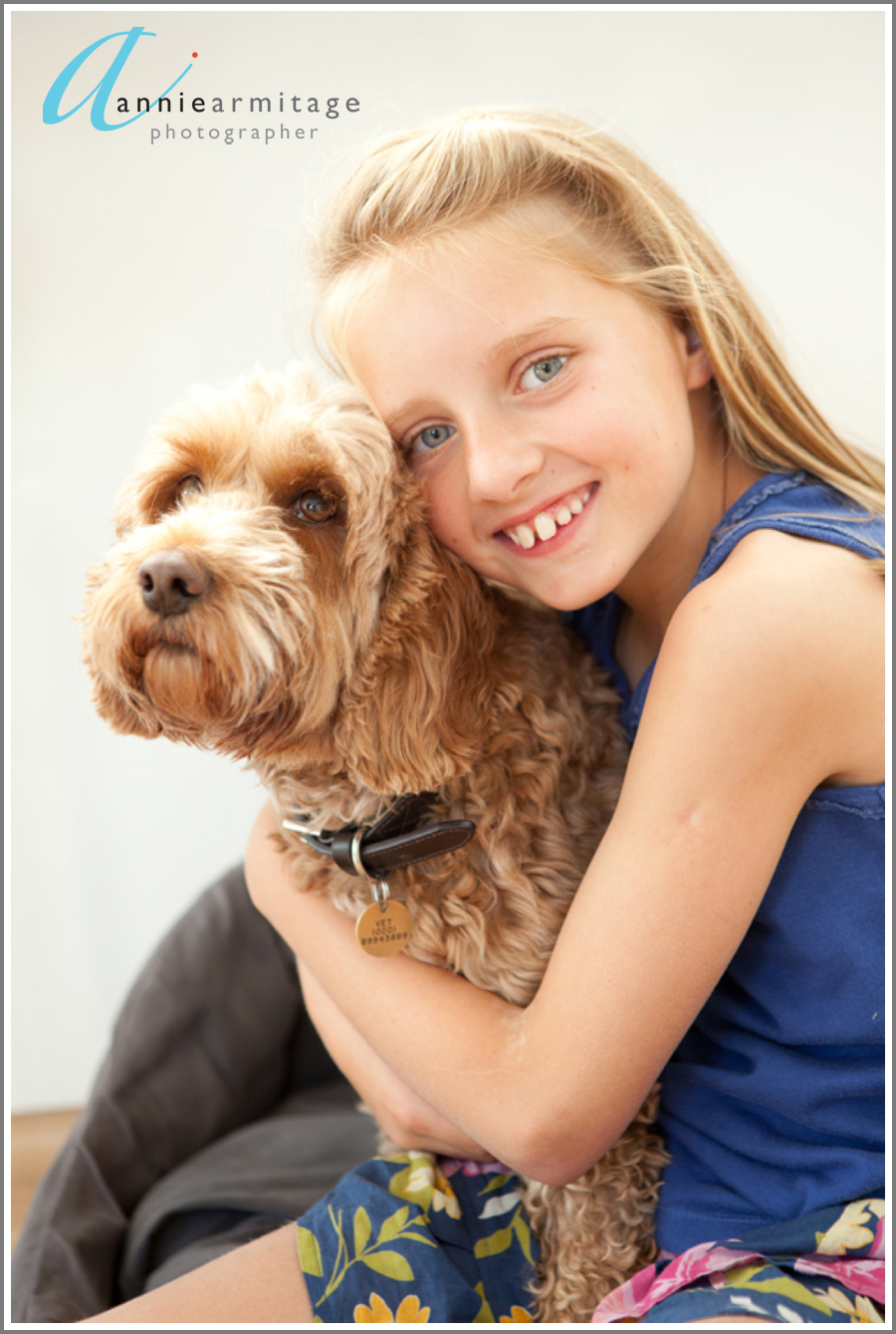 Portrait of young girl and her warm hearted dog in Kew, Richmond