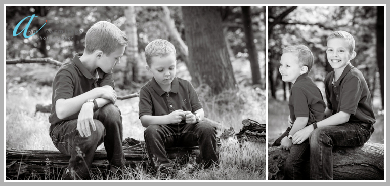 Two boys from Wimbledon in the park sitting on a log a black and white photo. They are playing and laughing
