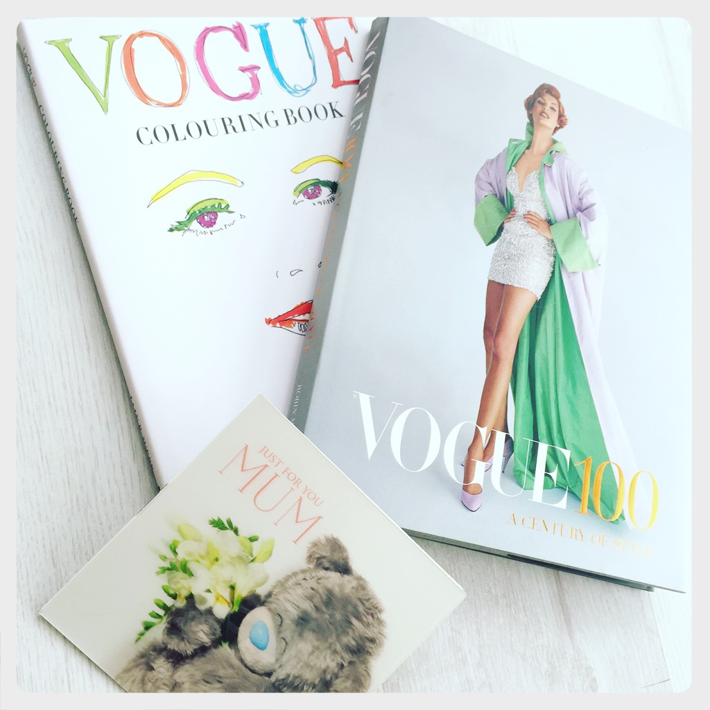 a vogue 100 book to accompany the exhibition at the national portrait gallery and the colouring book with a mother's day card