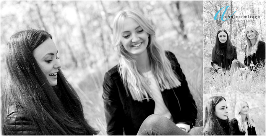a black and white photograph of two young women who are sisters laughing sitting in the grass on Wimbledon common