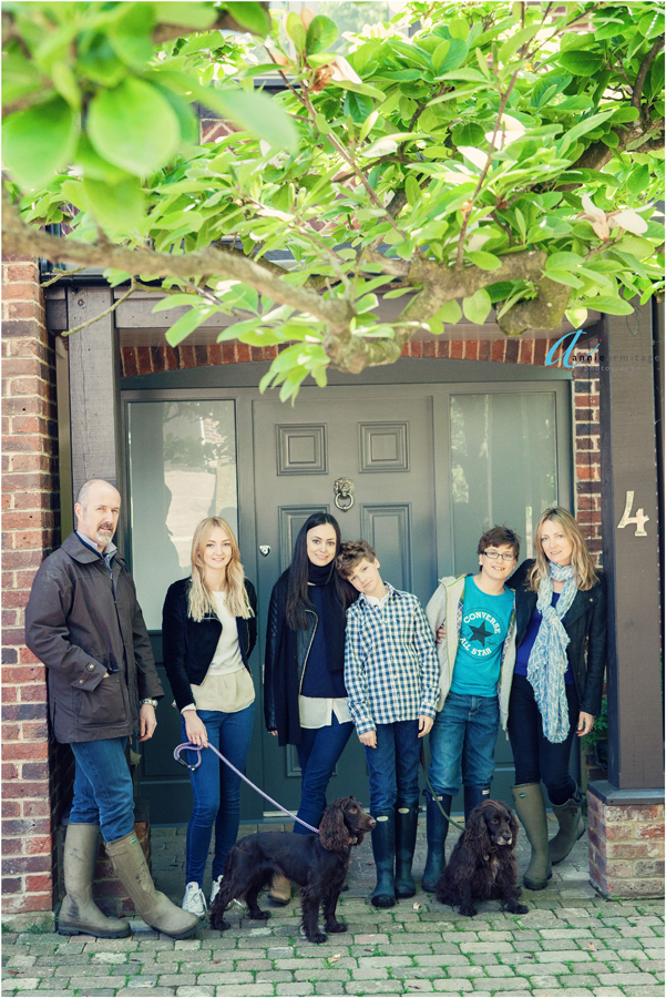 the family on the doorstep of their home in SW19 Wimbledon which has a number 4 and the magnolia tree