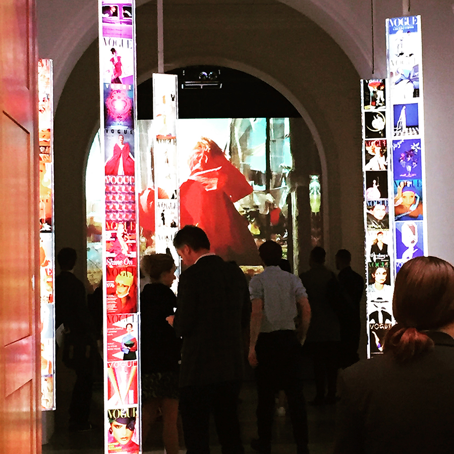 the entrance to the vogue 100 exhibition with front covers of Vogue over the years in many colours