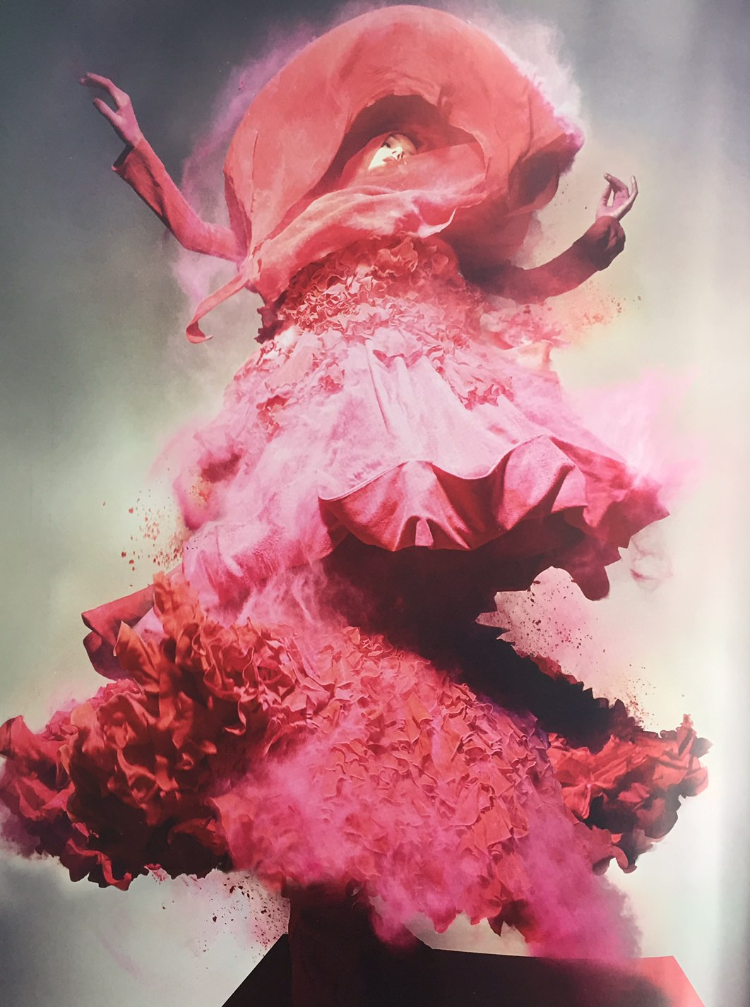 a woman who has had pink powder explode over her