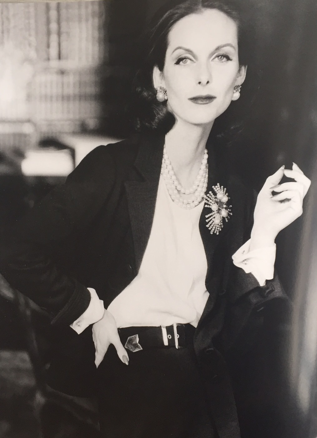 Anne Saint Marie posing for a picture wearing a black jacket and a white blouse