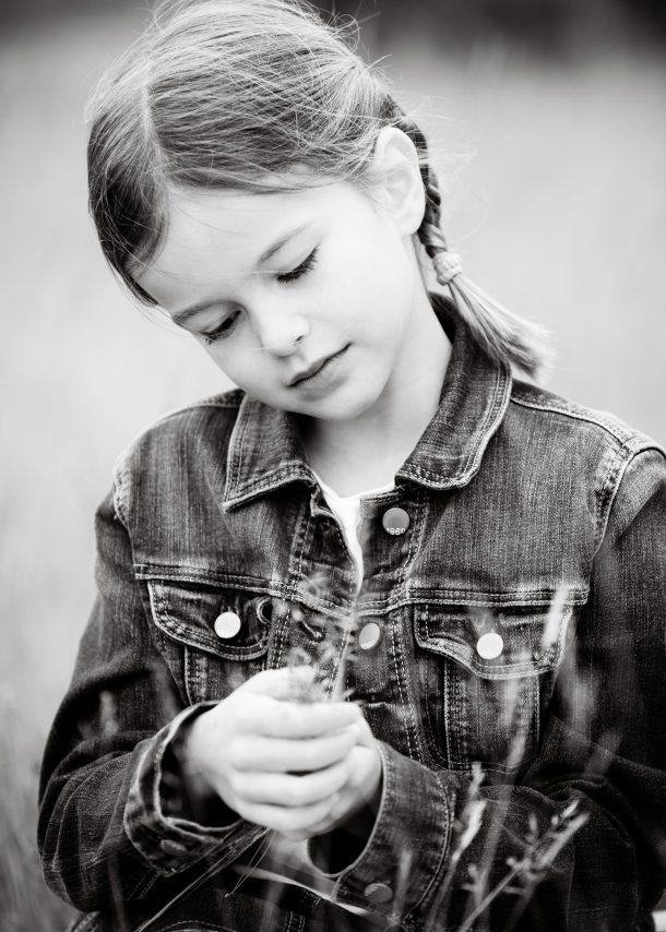 Girl holding a piece of grass