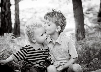 two young brother kiss each other in Richmond upon thames