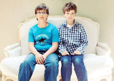 two brothers in Wimbledon sit on a louis iv seat looking serious