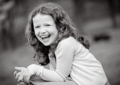 a 6 year old girl laughing in Chiswick