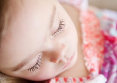 a little girls long eyelashes which she is asleep in Putney
