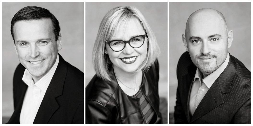 black and white headshots of three employees looking at the camera in business suits