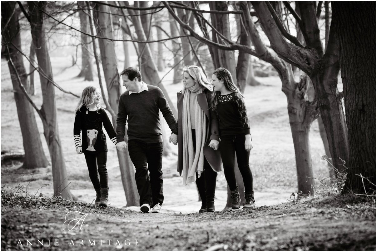 a teenage family walking through the woods on a early spring day mother and father and two daughter