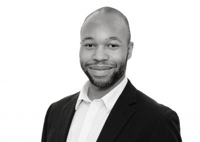 black and white company team headshots of a MAN
