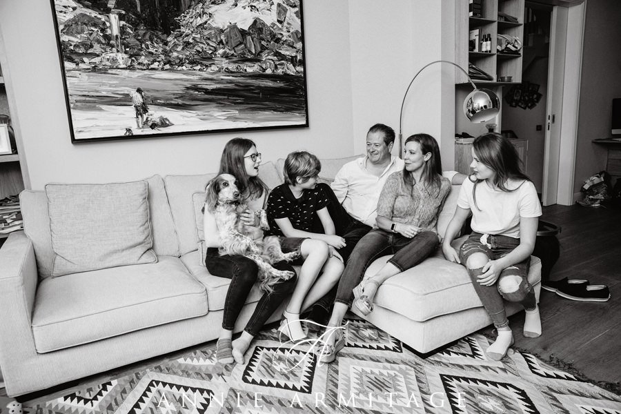 black and white photo of the family casually sitting on the sofa