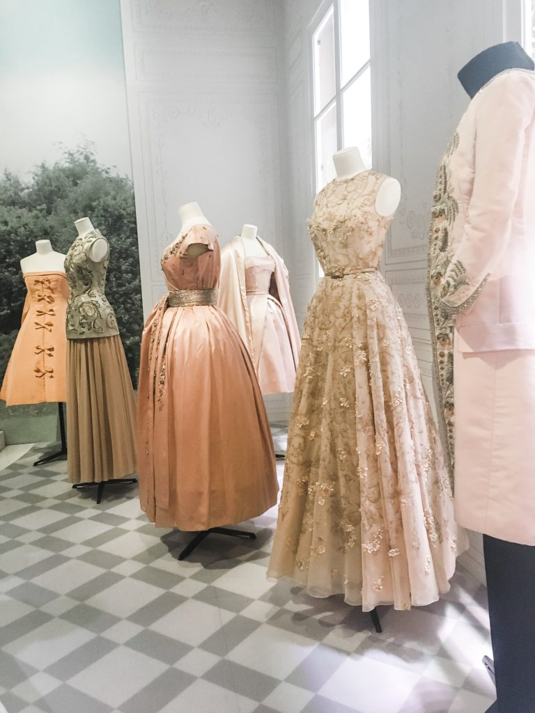 pastel coloured Dior dresses at the start of the V&A exhibition