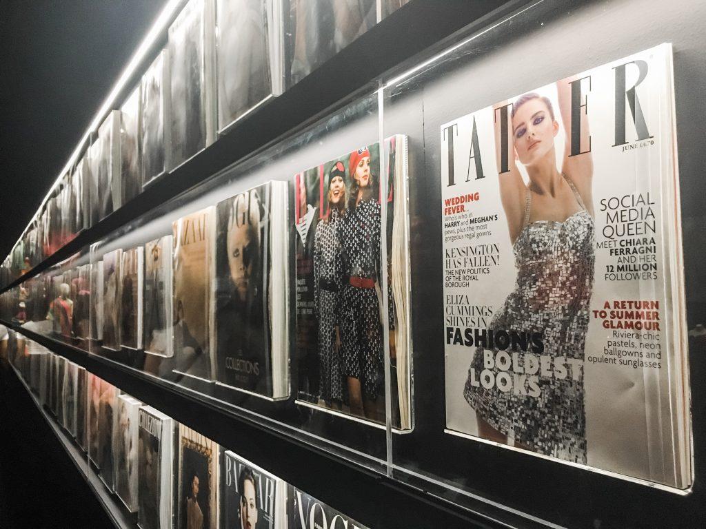 a wall of fashion magazines